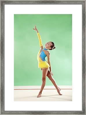 Gymnast, Smiling, Pose, Arm Up Framed Print by Emma Innocenti