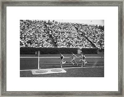 Track Athletes Running On Track, (b&w), Elevated View Framed Print by George Marks