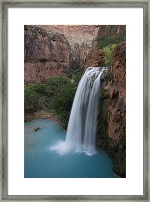 A Blue Waterfall Wets The Arid Framed Print by Taylor S. Kennedy