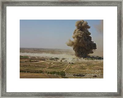 A Cloud Of Dust And Debris Rises Framed Print by Stocktrek Images