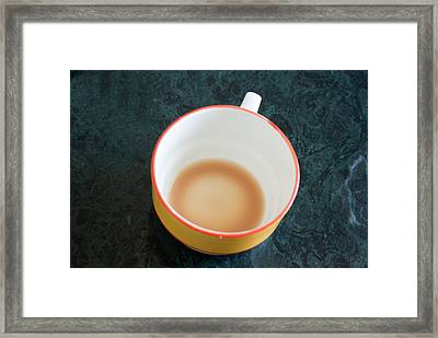 Framed Print featuring the photograph A Cup With The Remains Of Tea On A Green Table by Ashish Agarwal
