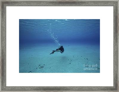 A Diver On A Scooter Explores The Clear Framed Print