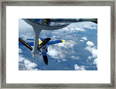 A Kc-135 Stratotanker Refuels An Fa-18 Framed Print by Stocktrek Images