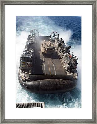 A Landing Craft Air Cushion Transits Framed Print