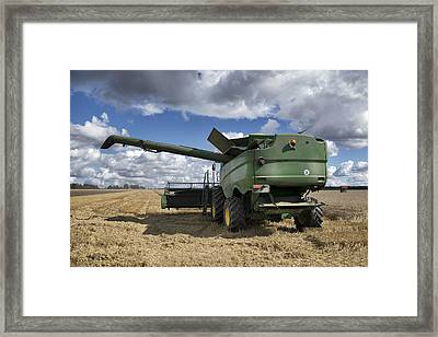 A Large Combine Harvester Machinery Framed Print by Jaak Nilson