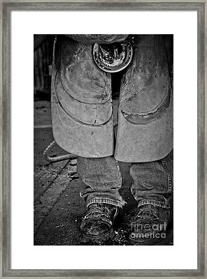 Framed Print featuring the photograph A Man At Work by Tamera James
