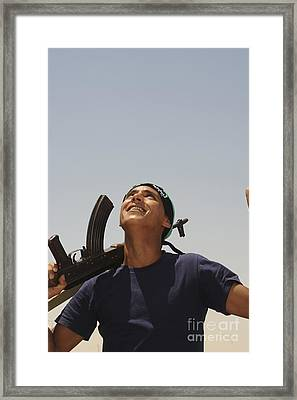 A Rebel Fighter With An Ak-47 Assault Framed Print by Andrew Chittock