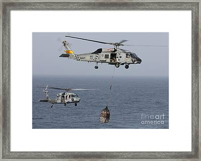 A Sh-60j Seahawk Transfers Cargo Framed Print