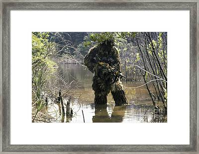 A Sniper Dressed In A Ghillie Suit Framed Print by Stocktrek Images