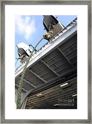 A Soldier Fast-ropes From The Rear Framed Print by Stocktrek Images