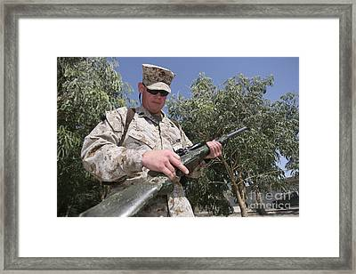 A Soldier Holds The M-40a1 Sniper Rifle Framed Print by Stocktrek Images