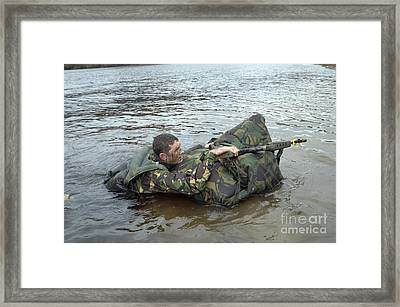 A Soldier Participates In A River Framed Print by Andrew Chittock