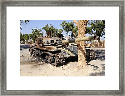 A T-72 Tank Destroyed By Nato Forces Framed Print by Andrew Chittock