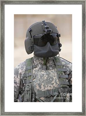 A Uh-60 Black Hawk Helicopter Crew Framed Print by Terry Moore