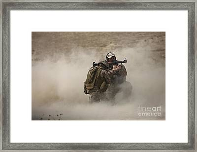 A U.s. Contractor Fires Framed Print by Terry Moore