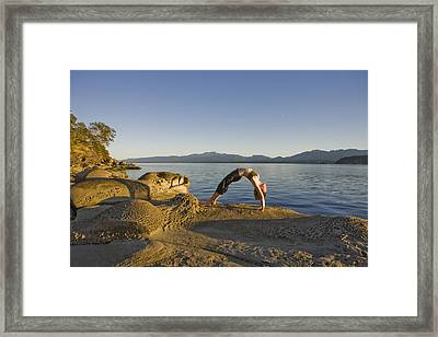 A Woman Does Yoga At Sunset Framed Print by Taylor S. Kennedy