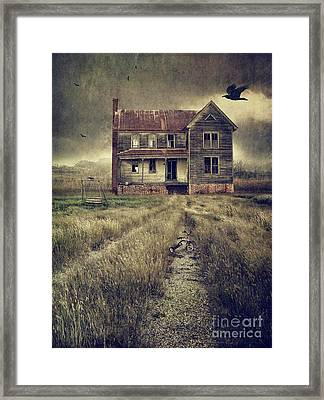 Abandoned Eerie Farmhouse With Dark Clouds Framed Print by Sandra Cunningham