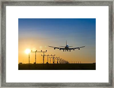Aeroplane Landing At Sunset, Canada Framed Print