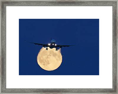 Airbus 330 Passing In Front Of The Moon Framed Print by David Nunuk