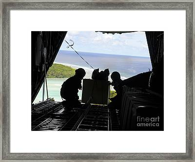 Airmen Push Out A Pallet Of Donated Framed Print