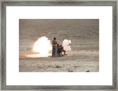 An Afghan Police Studen Fires Framed Print