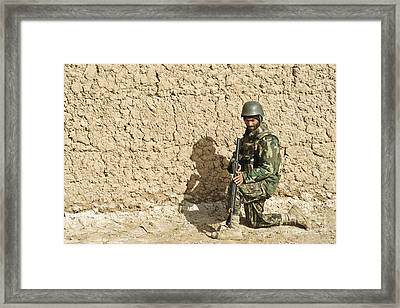 An Afghan Soldier Provides Security Framed Print