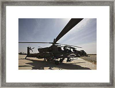 An Ah-64d Apache Helicopter Parked Framed Print by Terry Moore