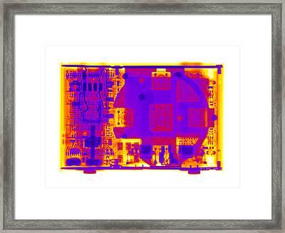 An Apple Ipod Shuffle Framed Print by Ted Kinsman