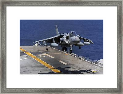 An Av-8b Harrier Jet Lands Framed Print by Stocktrek Images