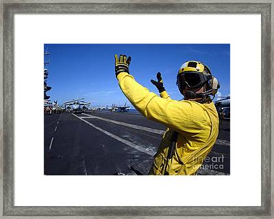 An Aviation Boatswains Mate Directs Framed Print by Stocktrek Images