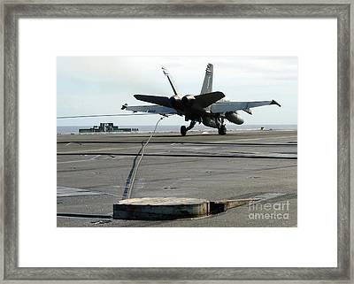 An Fa-18c Hornet Makes An Arrested Framed Print by Stocktrek Images