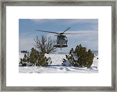 An Hh-60g Pave Hawk Flys Low Framed Print by HIGH-G Productions