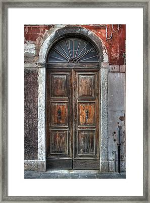 an old wooden door in Italy Framed Print