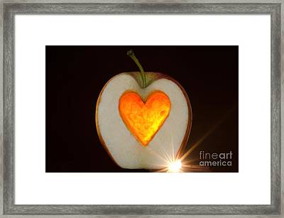 Apple With A Heart Framed Print by Mats Silvan