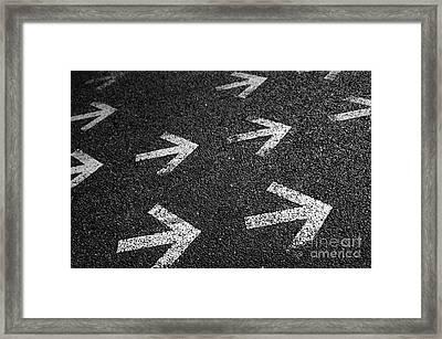 Arrows On Asphalt Framed Print by Carlos Caetano