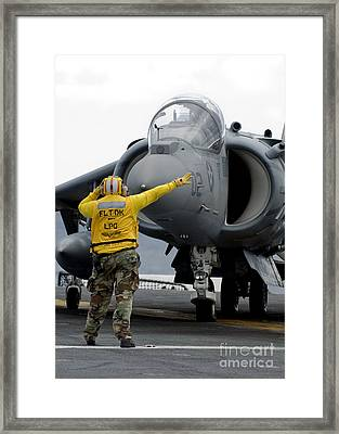 Aviation Boatswains Mate Directs Framed Print by Stocktrek Images