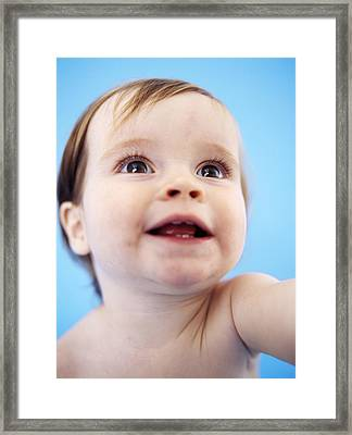 Baby Girl's Face Framed Print by Ian Boddy