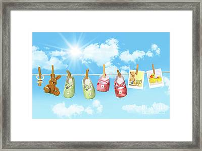 Baby Shoes And Teddy Bear On Clothline Framed Print by Sandra Cunningham