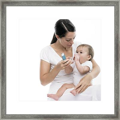 Baby Using An Asthma Spacer Framed Print by