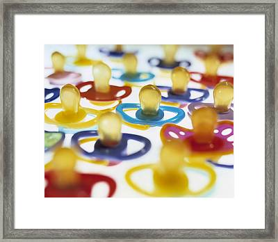 Baby's Dummies Framed Print by Lawrence Lawry