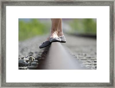 Balance On Railroad Tracks Framed Print