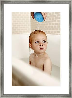 Bathing Child Framed Print by Ian Boddy
