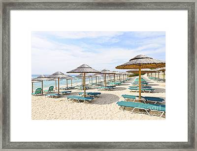 Beach Umbrellas On Sandy Seashore Framed Print