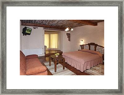 Bed In Hotel Room Framed Print by Jaak Nilson