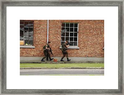 Belgian Soldiers On Patrol Framed Print by Luc De Jaeger