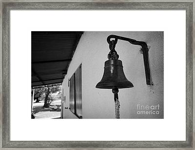 bell outside a small historic typical farm in Colonia Del Sacramento Uruguay South America Framed Print by Joe Fox