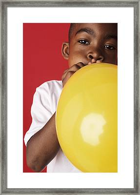 Blowing Up A Balloon Framed Print by Ian Boddy