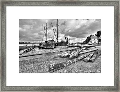 Boats And Logs At Pin Mill  Framed Print by Gary Eason