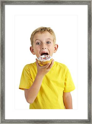 Boy Eating A Doughnut Framed Print by Ian Boddy