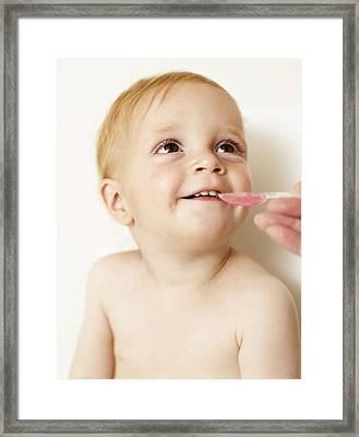 Boy Taking Medicine Framed Print by Ian Boddy